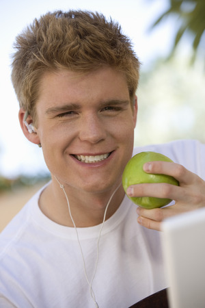 20 25 years old: Man Holding Apple