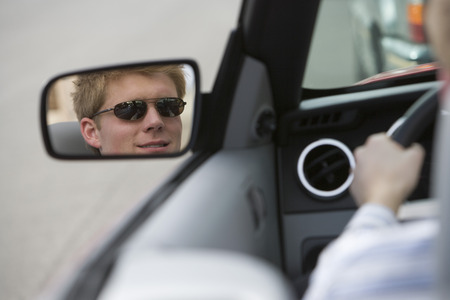 Woman in Side-View Mirror of Car Stock Photo - 5449728