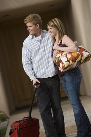 Young couple waiting with luggage Stock Photo - 5449731
