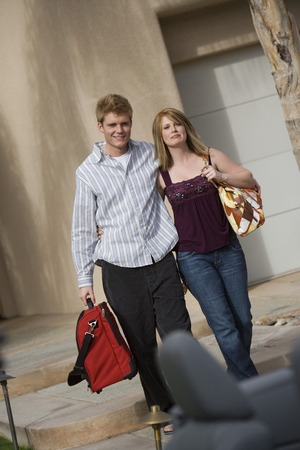 Couple Holding Luggage Stock Photo - 5449732