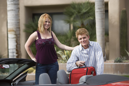 30 years old man: Couple Loading Luggage in Car LANG_EVOIMAGES