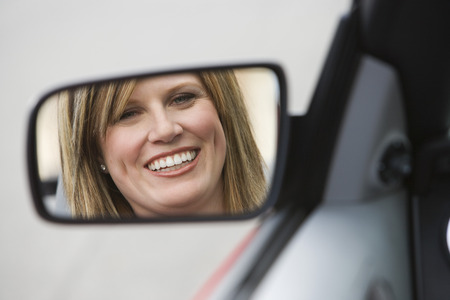 25 30 years women: Woman in Side-View Mirror of Car