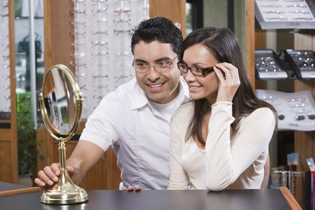 Man and woman trying on eyeglasses in store Stock Photo - 5449778