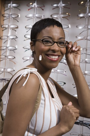 Woman trying on eyeglasses in store Stock Photo - 5449817