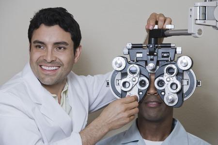 Optometrist examining patient's eyes Stock Photo - 5449844