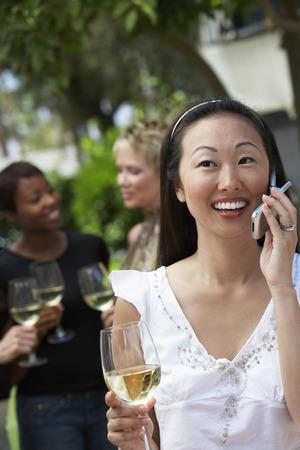 mingle: People Celebrating in Garden LANG_EVOIMAGES