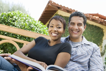 middle easterners: Couple relaxing in back yard, portrait