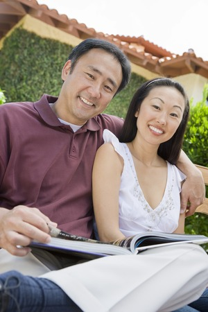 Couple relaxing in back yard, portrait Stock Photo - 5449872