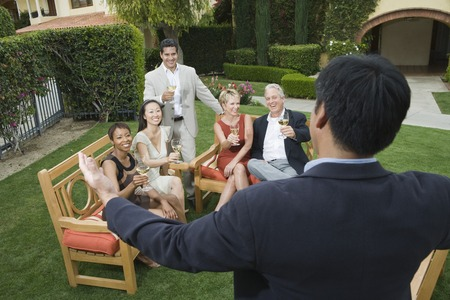 Group of friends relaxing outdoors Stock Photo - 5449898