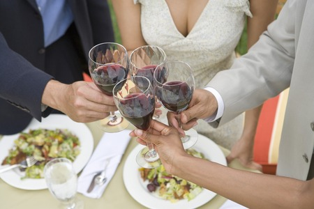 Friends toasting wine outdoors, close-up Archivio Fotografico - 5449954