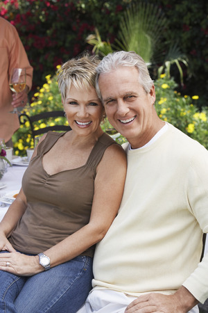 late forties: Smiling Couple Relaxing Outdoors