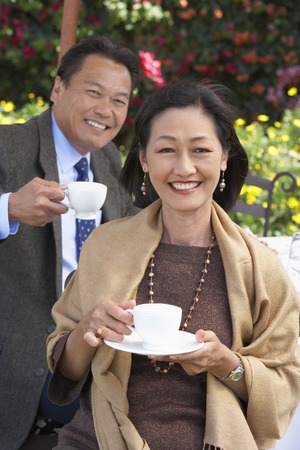 richness: Smiling Couple With a Cup of Tea LANG_EVOIMAGES
