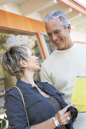 Couple Reading a Brochure Together Stock Photo - 5449967