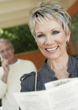 only mature women: Smiling Woman Reading a Brochure