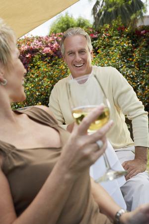 late 40s: Couple Enjoying a Glass of Wine