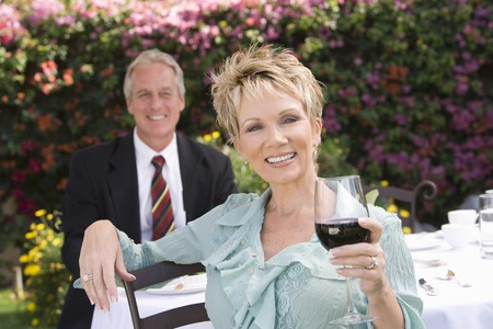 Couple drinking wine outdoors, portrait Stock Photo - 5450009