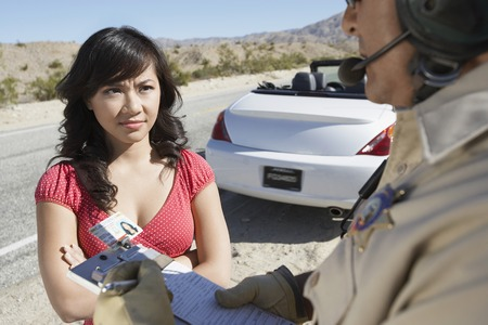 motor officer: Woman Receiving Speeding Ticket