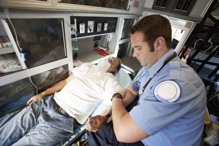 laboring: Person Receiving Aid Inside an Ambulance