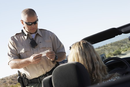 Woman Receiving Speeding Ticket Stock Photo - 5460020