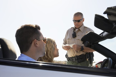 Couple Getting Pulled Over for Speeding Stock Photo - 5460021