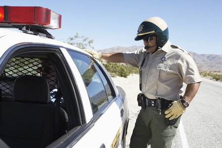 motor officer: Police Officer Arresting a Man