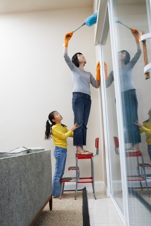 Girl Helping Mother with Dusting Stock Photo - 5460076