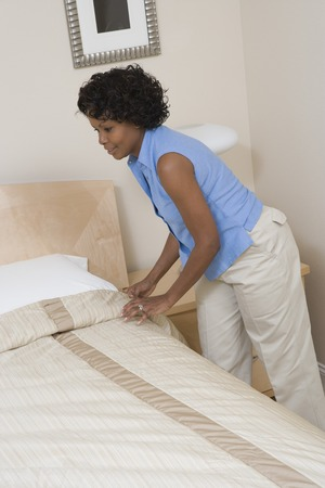 Woman making a bed Stock Photo - 5460087