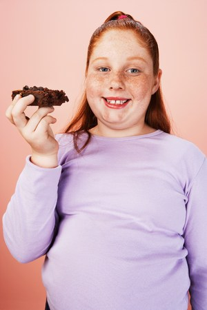 unhealthiness: Overweight Child Eating Junk Food