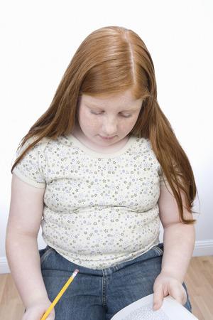 obese girl: Teenage girl learning