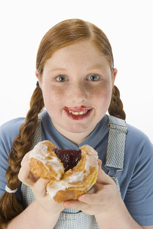 Overweight girl holding pastry, portrait Stock Photo - 5460241