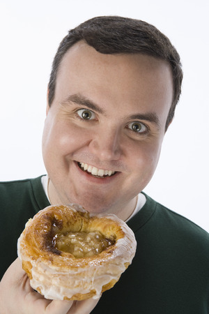 Mid-adult man holding pastry Stock Photo - 5460245