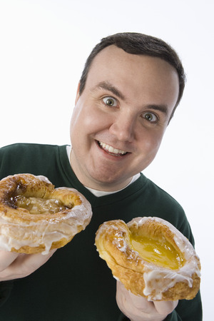 Mid-adult man holding pastry Stock Photo - 5460247