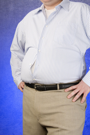Overweight Man standing with unbuttoned shirt, hands on hip, mid section Stock Photo - 5460276