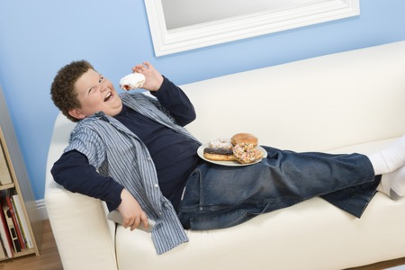 Boy Eating Donuts Stock Photo - 5460307