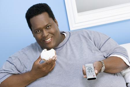 太りすぎの人はテレビを見て 写真素材 - 5460310