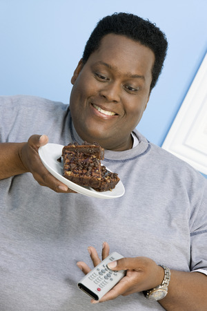 Overweight man eating cake Stock Photo - 5460311