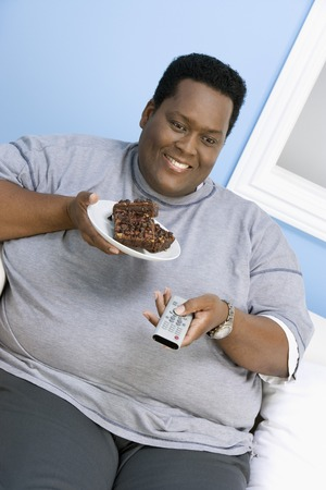 unhealthiness: Man Eating Brownies LANG_EVOIMAGES