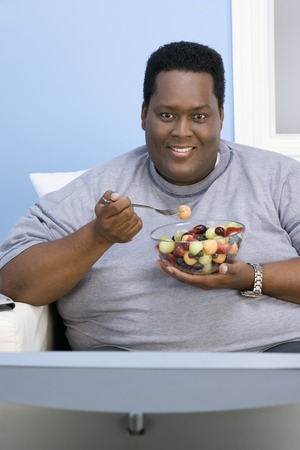 balanced diet: Man Eating Bowl of Fruit