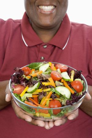太りすぎの男サラダ、中央部を押し 写真素材 - 5460325