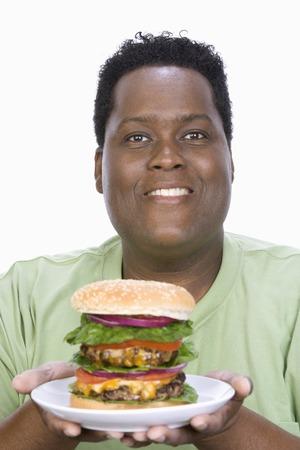 unhealthiness: Man Holding Hamburger