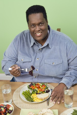 40 to 45 years old: Man Eating Fruits and Vegetables