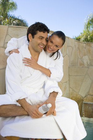 Couple relaxing by swimming pool Stock Photo - 5460399