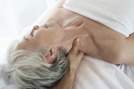 the ageing process: Senior woman having massage