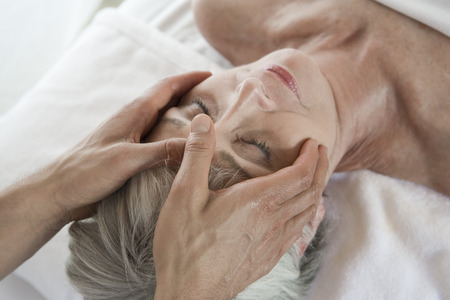 Senior woman having head massage Stock Photo - 5470025