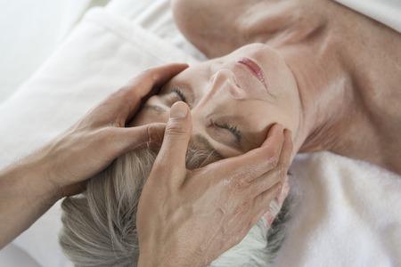Senior woman having head massage Stock Photo - 5470025