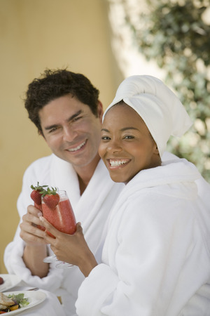 Portrait of couple in bathrobes, drinking at health spa Stock Photo - 5470090
