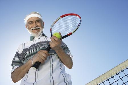 Smiling Man on the Tennis Court Stock Photo - 5470112