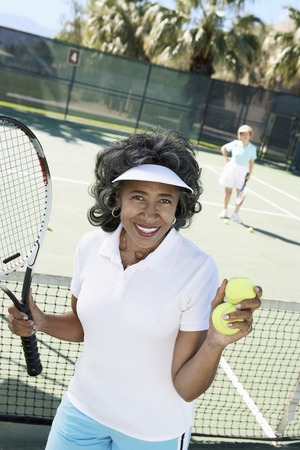 tennis racquet: Smiling Woman Perparing to Serve