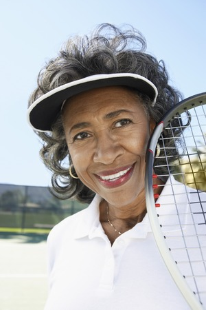 Smiling Woman on the Tennis Court Stock Photo - 5470114