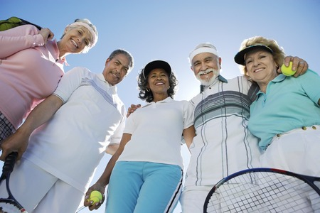 retirees: Happy Couples on the Tennis Court LANG_EVOIMAGES
